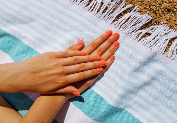 bright summer nails on beach towel